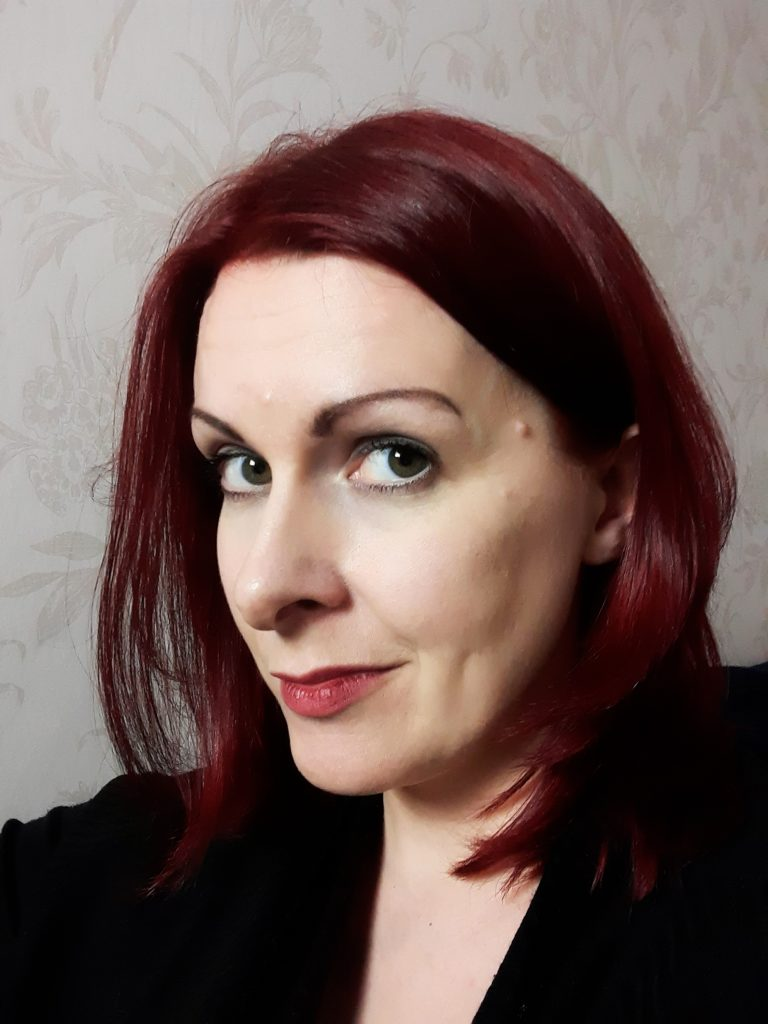 Head shot of Jen McGregor. She is a white woman in her 30s with shoulder length dark red hair.